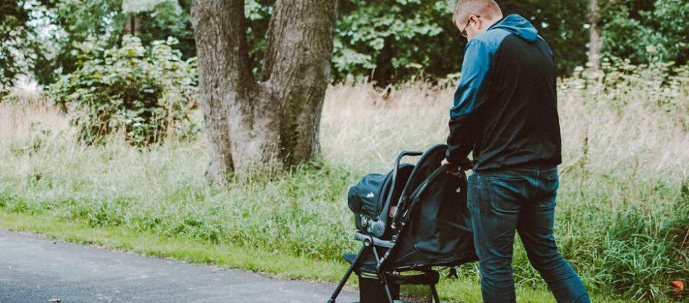 a man pushing a baby pram