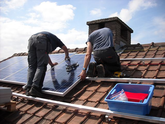 two men installing commercial solar