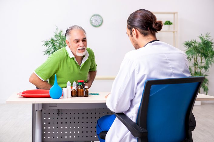A young male doctor advising a patient to take a gastroscopy Melbourne procedure