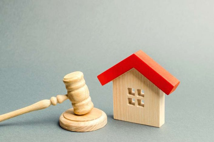Miniature of a wooden house and a gavel