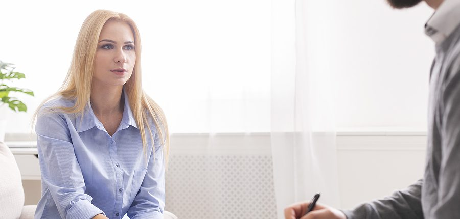 Woman consulting an attention deficit hyperactivity disorder specialist