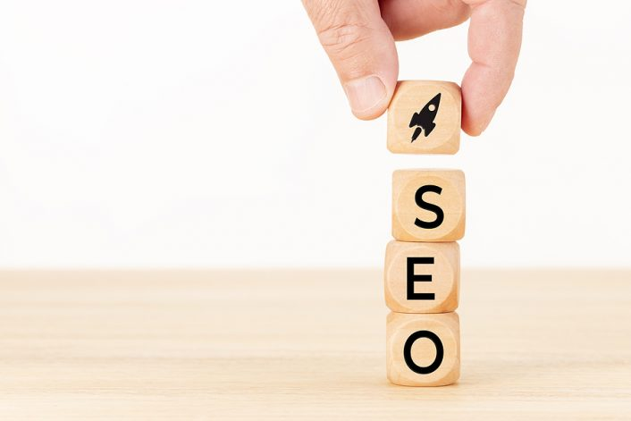 Wooden block with rocket icon and SEO letters